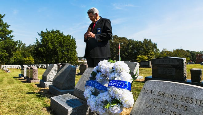 """FBI chaplain David Ard pauses after reading Psalm 90:9-10 during a wreath-laying ceremony honoring W.H. Drane Lester at Magnolia Cemetery in Batesville on Thursday. Lester coined the FBI motto: """"Fidelity, Bravery, Integrity."""" Lester practiced law in Memphis before joining the FBI during the era of Dillinger and Pretty Boy Floyd."""