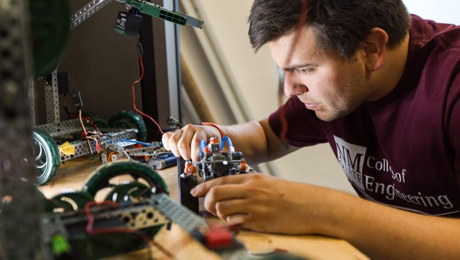 Industrial engineering graduate student and Aggie Innovator Luis Martinez, along with other Aggie Innovators, helps students with classroom projects as well as projects that may have commercialization value at the NMSU College of Engineering Aggie Innovation Space.