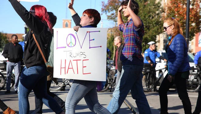 """""""Love trumps hate"""" was one message delivered by anti-Trump protesters Downtown on Saturday."""
