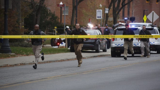 Police respond to reports of an active shooter on campus at Ohio State University on Monday, Nov. 28, 2016, in Columbus, Ohio.