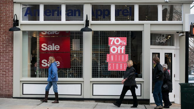 December 12, 2016 - People pass clothing store American Apparel, located at 528 S. Main St., on Monday. This Memphis location will close at the end of the month as part of a national downsizing following the chain's bankruptcy filing in November.