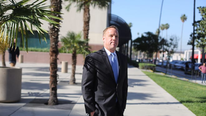 Former Palm Springs mayor Steve Pougnet leaves the Riverside Hall of Justice following an appearance Friday, April 21, 2017. He was scheduled to be arraigned in a bribery case, but the hearing was pushed to May 19.
