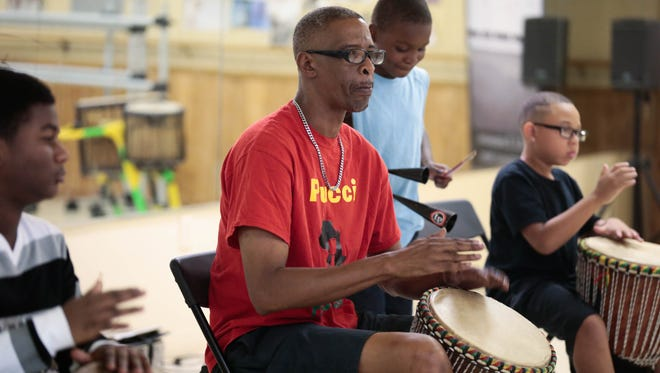 """Herbert """"Pucci"""" Green leads students in an African and Latin percussion clinic in Lafayette in June 2017. Green and other musicians in his program will perform at Plantation Elementary on Feb. 23, 2018."""