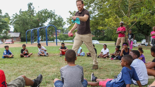Cincinnati's new parks director, Wade Walcutt, visited a summer camp in Roselawn on Aug. 2. He played a game with the kids that taught the importance of communication and encouragement when you work as a team.
