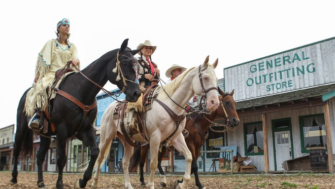 Old West Festival in Williamsburg prepares for its final two weekends in 2017. (From left) Renee Flick, Ginger Patrick and Gunnar Williams ride Achilles, Anthem and Salish.