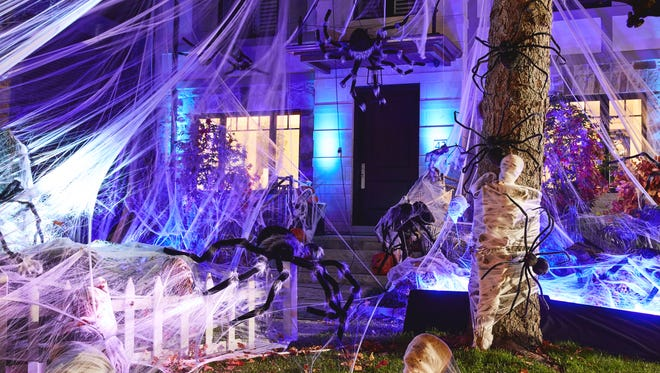 This undated photo provided by Party City shows a Halloween themed display in a front yard. Halloween offers the first big chance of fall to decorate your home, and there are lots of ways — from spooky to sweet — to get into the holiday spirit. (Party City via AP)