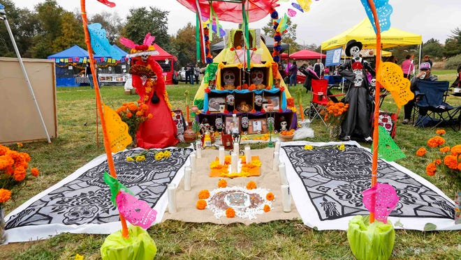 An alter remembering the dead is pictured during Dia De Los Muertos/Day of the Dead at Natividad Creek Park on Sunday, October 29, 2017 in Salinas.