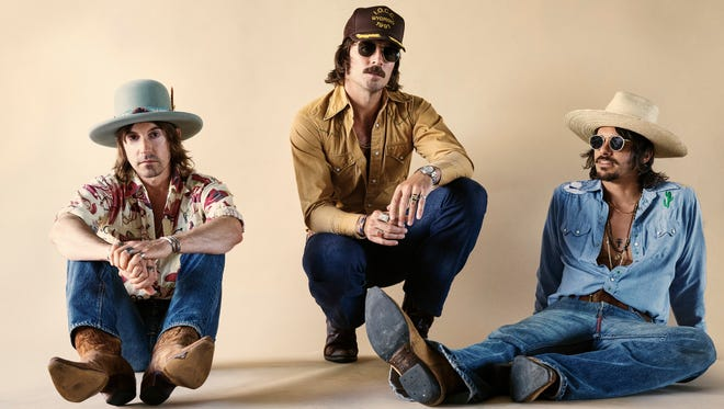 """Midland's first single """"Drinkin' Problem"""" became their first No. 1 hit in 2017."""
