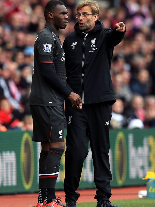 Liverpool manager Jurgen Klopp instructs Christian Benteke as he prepares to come on as a substitute during the English Premier League soccer match between Southampton FC and Liverpool FC at the St Mary's Stadium in Southampton. England. Sunday March 20, 2016. (Adam Davy / PA via AP) UNITED KINGDOM OUT - NO SALES - NO ARCHIVES