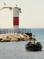 A fishing boat enters the Two Rivers Harbor on Wednesday.