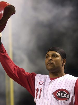 Former Cincinnati Reds shortstop Barry Larkin, a Hall of Famer, was the 1995 National League MVP. He is seen here taking a curtain call after hitting a pinch-hit grand slam in a July 28, 2004, loss to to the St. Louis Cardinals in Cincinnati. St. Louis won 11-10.