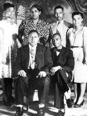 Harry T. Moore (standing) founded the Brevard County branch of the NAACP, was a respected educator, and registered more than 100,000 African Americans to vote. He was the first martyr of the contemporary civil rights movement.
