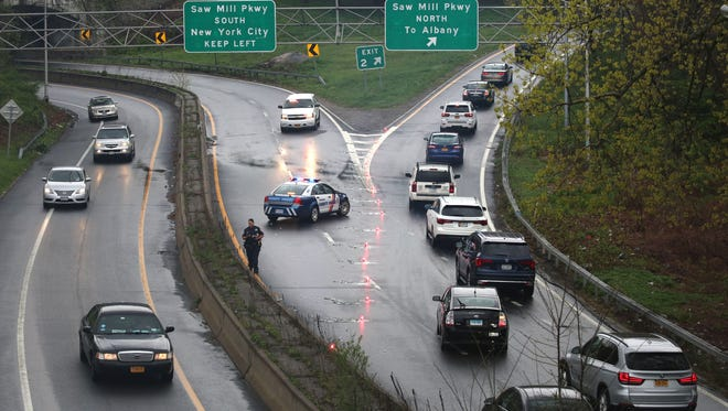 Westchester County Police close the southbound exit for the Saw Mill River Parkway from the Cross County Parkway west, as they investigate an auto accident, April 23, 2016.