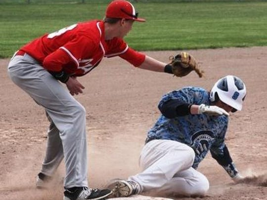 Canton second baseman Justin Dolney tags out a Livonia