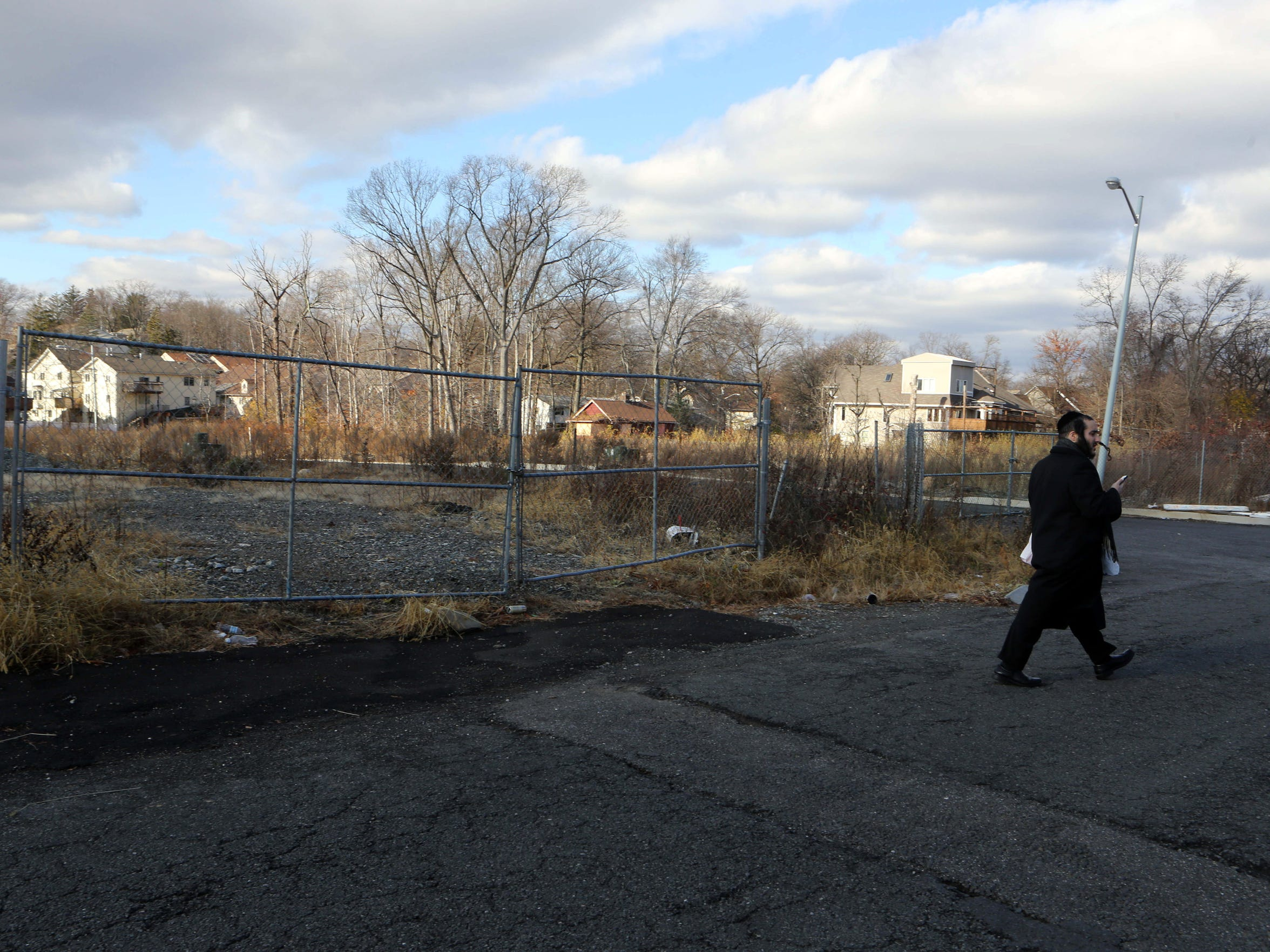 Twelve housing units are planned for a vacant lot on