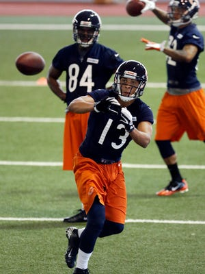 Dale Moss catches a ball during NFL football rookie camp while with the Bears in 2013.