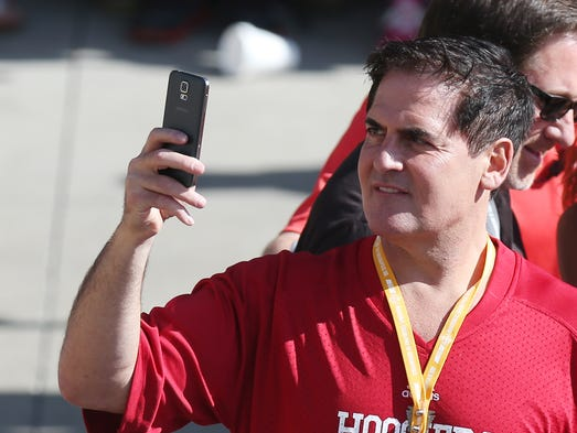 Businessman Mark Cuban takes in the scene on the red