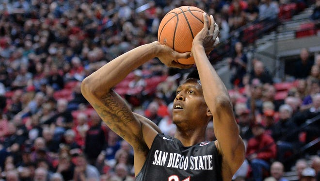 San Diego State Aztecs forward Malik Pope (21) shoots during the first half against the UNLV Rebels at Viejas Arena.