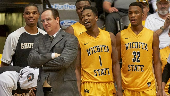 Wichita State Shockers head coach Gregg Marshall (L) looks on from the sidelines during the second half against the Missouri State Bears at Charles Koch Arena.