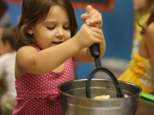 The exploratory cooking classes at Young Chef's Academy show kids that cooking can be fun and education with science, math, reading and other social skills infused into the cooking course.