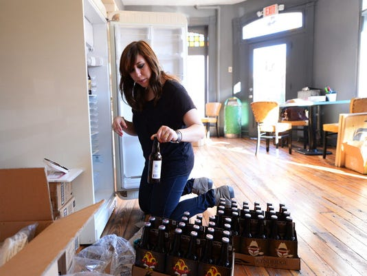Manager Allison Given stocks soda from Wyndridge Farm at 56 Urban Provisions in November 2014.