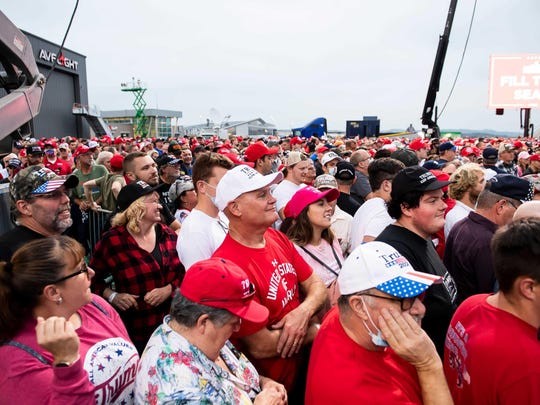 Thousands of Donald Trump supporters wait for the start of a campaign rally Saturday at Harrisburg International Airport in Middletown, Pa.