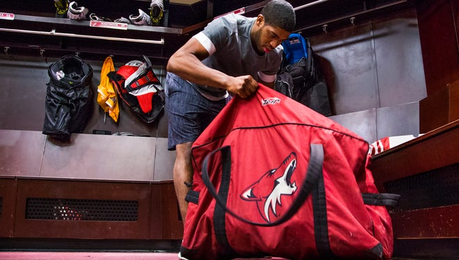 Arizona Coyotes rookie Anthony Duclair cleans out his locker at Gila River Arena as the NHL season has come to an end for the team.