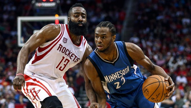 Minnesota Timberwolves forward Andrew Wiggins (22) attempts to drive the ball around Houston Rockets guard James Harden (13) during the third quarter at Toyota Center.