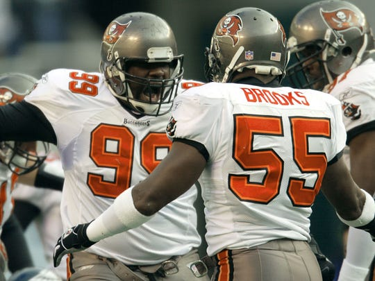 Warren Sapp and Derrick Brooks celebrate in the first quarter of the NFC Championship Game.