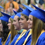 From left, Brooke Trepanier, Emma Trepanier, Alex Ebeling, Dustin Linney and Kelly Stewart smile at a comment during salutatorian Bryce Gallagher's remarks at the Oconto High School graduation ceremony on May 29.