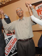 Mayoral candidate Chokwe Lumumba  celebrates his victory over runoff candidate Jonathan Lee with his son Chokwe Antar Lumumba  and daughter Rukia Lumumba to the cheers and applause of supporters in 2013 at the Clarion Hotel in north Jackson.
