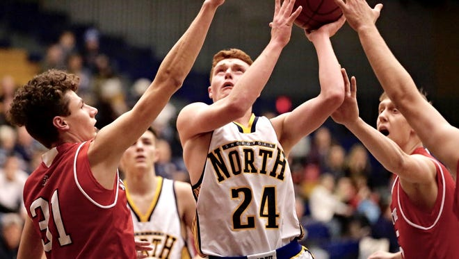 Sheboygan North's Brent Widder drives to the basket against Manitowoc during Friday's game in Sheboygan.