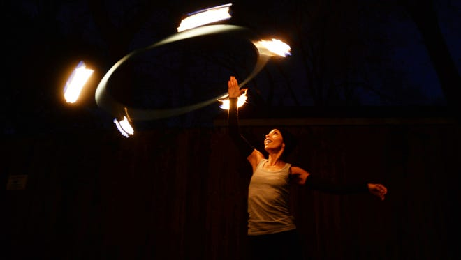 Hooper Jennifer DooLittle spins fire at Lotus Studio's New Year's Eve burn