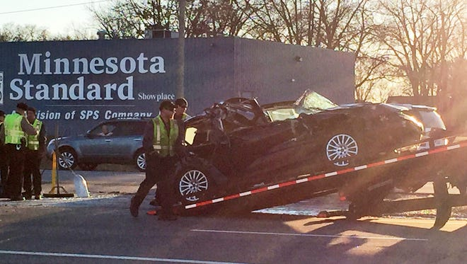 A car is loaded Thursday after a collision in east St. Cloud.