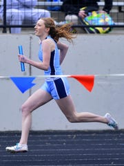 Morgan Evans runs the anchor leg on Great Falls High's