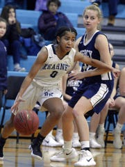 Bishop Kearney's Marianna Freeman, left, drives the
