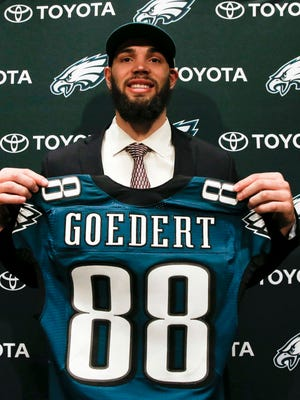 Philadelphia Eagles draft pick Dallas Goedert, a tight end from South Dakota State, smiles while holding his jersey before meeting with the local media Saturday, April 28, 2018, in Philadelphia.