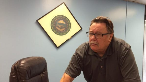 Delaware County Council president Mike Jones talks to county employees after council's meeting on Tuesday, July 22.