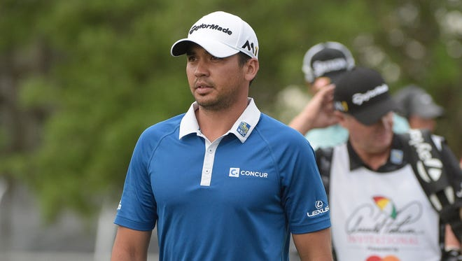 Jason Day, left, of Australia, walks to the 11th tee during the second round of the Arnold Palmer Invitational golf tournament Friday in Orlando,  Fla.