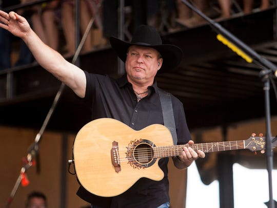 John Michael Montgomery takes the main stage on day four of the Country Thunder Music Festival Sunday, April 12, 2015, in Florence.