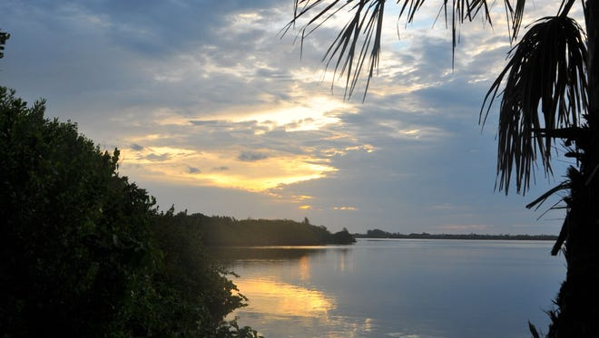 The sun rises over the Banana River near the Pineda Causeway on Tuesday, April 21, 2015.