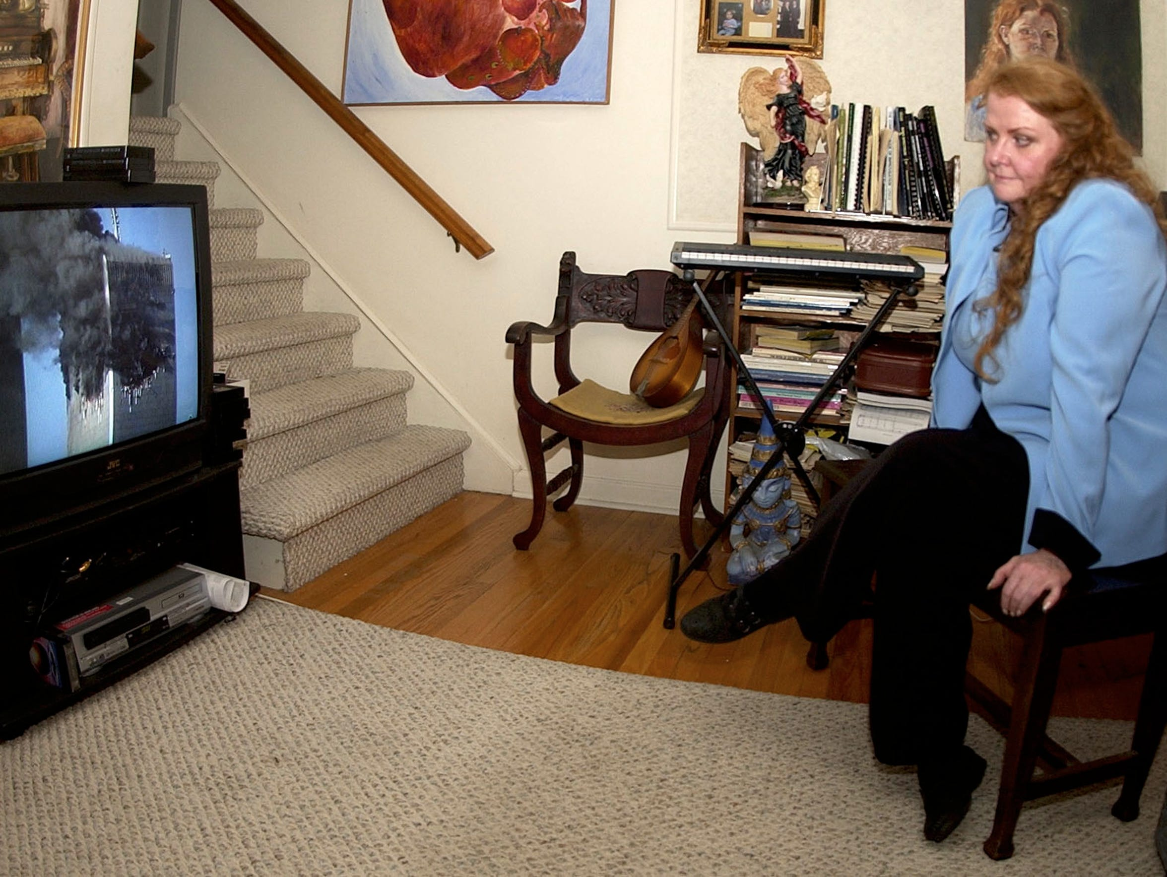 Margaret Gramly watches a DVD on 9/11 in her New Jersey