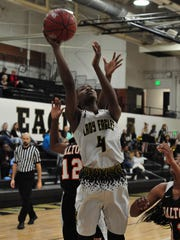 Abilene High's Maya Taylor goes up for a layup during