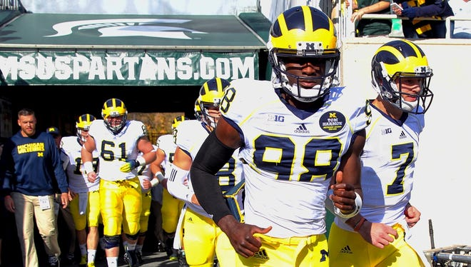 The Michigan football team comes on the field to play Michigan State on Oct. 26, 2014.