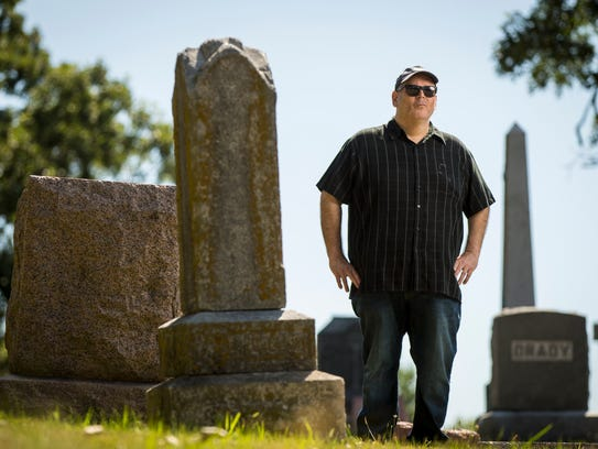 Anthony Garza near the suspected unmarked grave of