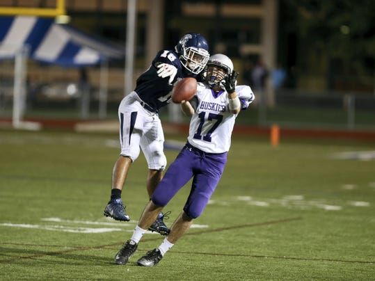 Chambersburg defensive back Darius Johnson, left, knocks down a pass intended for Nathan Bargo (17) of Mifflin County during the Trojans' 28-7 win Friday night.