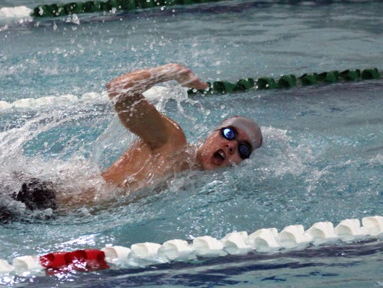 Shippensurg's Eli Zinn swims a freestyle race against