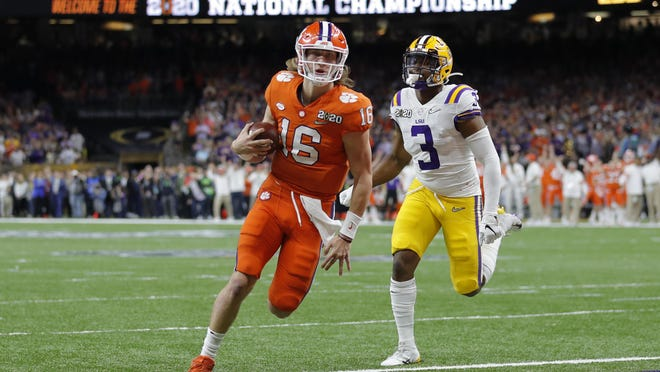 Clemson quarterback Trevor Lawrence scores past LSU safety JaCoby Stevens during the first half of the College Football Playoff national championship game Jan. 13 in New Orleans. LSU won 42-25.