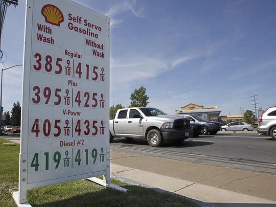 Gas prices are displayed last month at a Shell station in Sacramento, California. Gasoline for that summer road trip will cost a bit more than experts in the federal government were expecting just a month ago. The government is also predicting higher crude prices, as higher U.S. production is offset by declines elsewhere.