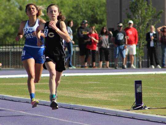 Clyde's Megan Smith edges past another runner into second place on the homestretch of the girls 3,200 at the Region I-3A Track and Field Meet at Abilene Christian University on Friday, April 27, 2018.